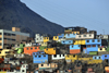 Lima, Peru: colorful shanty town under Cerro San Cristóbal - photo by M.Torres