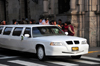 Lima, Peru: GAZ Volga limo brings a bride to her wedding - Archbishop's palace in the background - photo by M.Torres