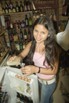 Lima, Peru: young woman bartender serving pisco sours - photo by D.Smith