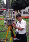 Miraflores, Lima, Peru: photographer with old time camera with photos in the main - photo by C.Lovell