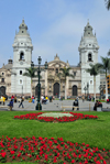 Lima, Peru: the Cathedral and flowers on Plaza de Armas - Francisco Pizarros' remains are in the interior - photo by M.Torres