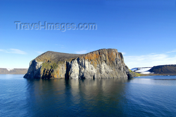 70 Franz Josef Land: Rubini Rock from ship - photo by B.Cain