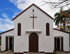 Port Mathurin, Rodrigues island, Mauritius: Catholic Church - white façade with cross - photo by M.Torres