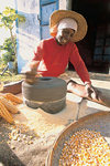 Rodrigues: woman preparing corn flour - photo by G.Soobraydoo