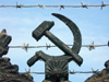 Russia - Udmurtia - Izhevsk: barbed-wire and a hammer and sickle - communist symbols - photo by P.Artus