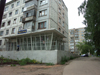 Russia - Udmurtia - Izhevsk: apartment building and food shop - photo by P.Artus
