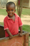 Rwanda: inquisitive boy in the back of a truck - photo by J.Banks