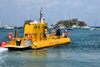 Gustavia, St. Barts / Saint-Barthélemy: the Yellow Submarine sets sail to the Marine Park of Saint Barth - semi-submersible tour ship - Les Gros Islets in the background - photo by M.Torres