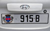 Gustavia, St. Barts / Saint-Barthélemy: car license plate - St Barts coat of arms - Maltese cross, the Fleur-de-lis, crown, pelicans, and the island's Amerindian name Ouanalao - Hyundai - photo by M.Torres