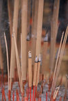 Singapore: Joss sticks outside a temple - Joss is a household deity and his cult image - incense burning (photo by S.Lovegrove / Picture Tasmania)