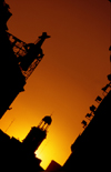 Spain - Madrid: sunset in Puerta del sol - silhouette of Tio Pepe and Casa de Correos - photo by K.Strobel