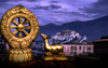 Lhasa, Tibet: Potala Palace seen from Jokhang Monastery - Dharmachakra wheel with flanking deer, the eight spokes represent the Noble Eightfold Path of Buddhism and the deer recalls Buddha's first sermon in Sarnath Deer Park - photo by Y.Xu