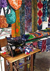 Lomé, Togo: SInger sewing machine and colorful fabrics - local fashion studio - photo by G.Frysinger