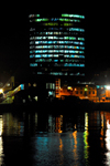 Port of Spain, Trinidad: office tower by the harbour - nocturnal image - photo by E.Petitalot