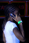 Port of Spain, Trinidad: girl with typical hairstyle using a mobile phone - photo by E.Petitalot