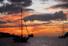 Trinidad: sunset in a Caribbean harbour - sailing boats and tanker - photo by E.Petitalot