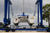 Port of Spain, Trinidad: taking a boat out of the water for repairs - mobile hoist and catamaran - boat handling Equipment - photo by E.Petitalot