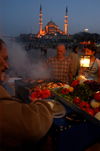 Istanbul, Turkey: grilled fish and New Mosque / yeni camii at night - photo by J.Wreford