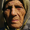 Agri province, Eastern Anatolia, Turkey: face of an old Kurdish woman with the Islamic scarf - photo by W.Allgöwer