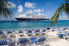 Grand Turk Island, Turks and Caicos: southwestern beach - palms, deckchairs and Holland America cruise ship Prinsendam - photo by D.Smith