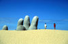 Uruguay - Punta del Este: the town's most famous landmark - hand in the sand sculpture, by Mario Irarrazabal - La Brava beach - photo by S.Dona'