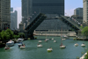 Chicago, Illinois, USA: a regatta of sail boats on the Chicago River pass under the Michigan Avenue bascule bridge - Double-leaf, double-deck, fixed counterweight, trunnion bascule - Edward H. Bennet architect - photo by C.Lovell