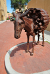Santa Fé, New Mexico, USA: sculpture of a donkey carrying firewood by Charles Southard - Old Burro alley, next to the Lensic theater on San Francisco Street - photo by M.Torres