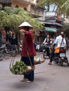 Hanoi / Ha Noi - vietnam: carrying baskets - photo by Robert Ziff