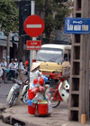 Hanoi - vietnam: street corner - Pho Tran Nhan Tong - no entry sign - photo by Robert Ziff