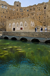 Hababah, Sana'a governorate, Yemen: buildings by the water cistern - arches of the water tank - photo by J.Pemberton
