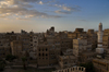 Sana'a / Sanaa, Yemen: view of the Old City at sun down - towers in the skyline - Harat Dawd quarter - UNESCO World Heritage Site - photo by J.Pemberton