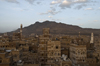Sana'a / Sanaa, Yemen: view over the Old City to the mountains - ancient skyscrapers - UNESCO World Heritage Site - photo by J.Pemberton